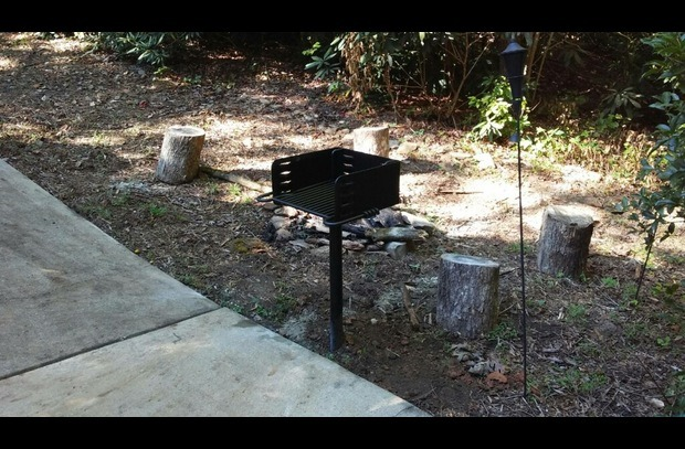 charcoal grill beside fire pit